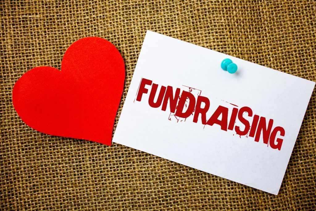 Conceptual hand writing showing Fundraising