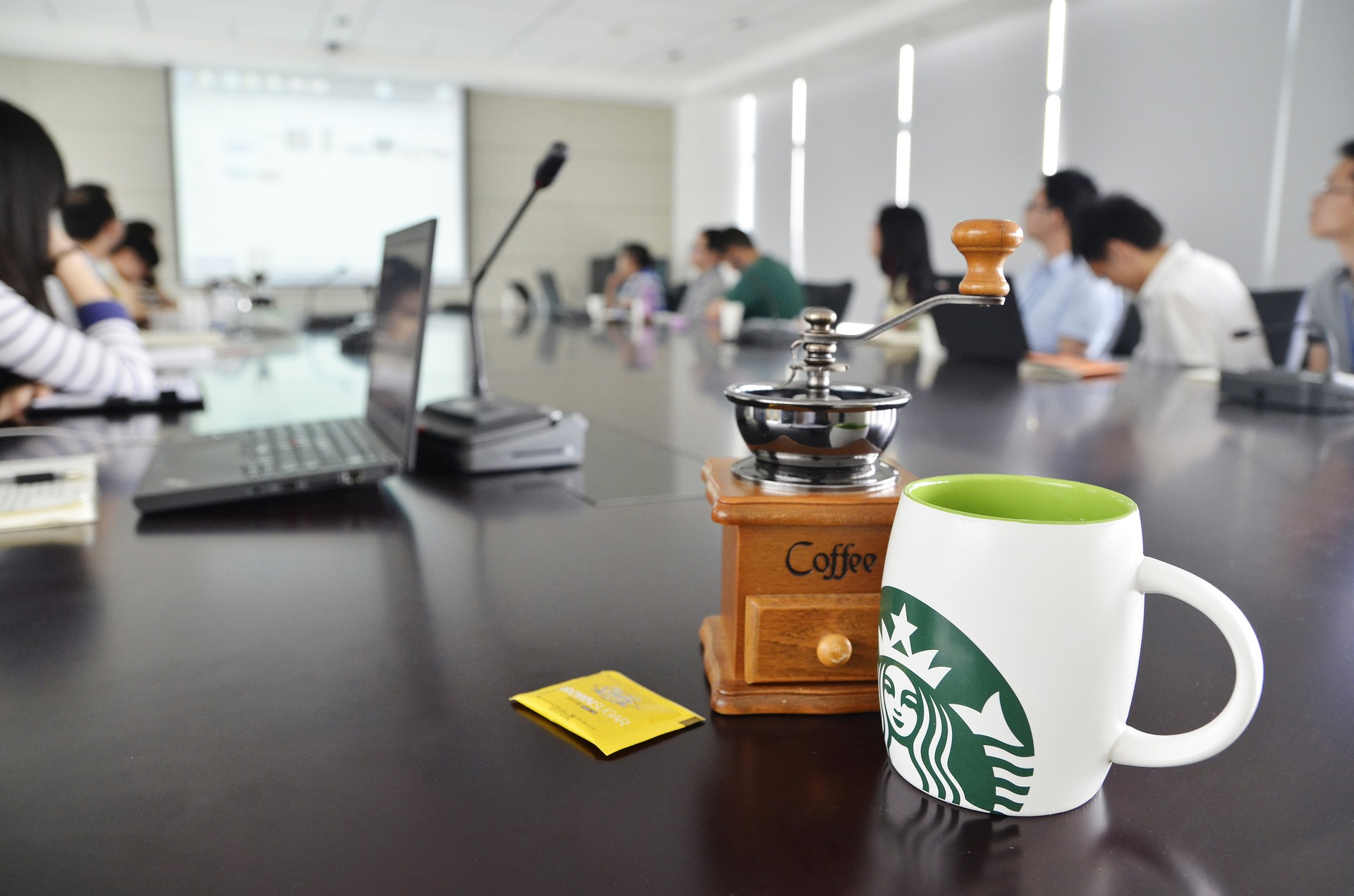 drinking-starbucks-in-a-conference-room