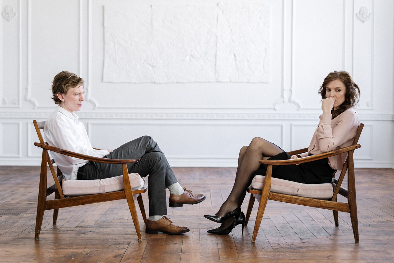 couple facing each other with visible tension