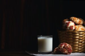 candle beside cookies