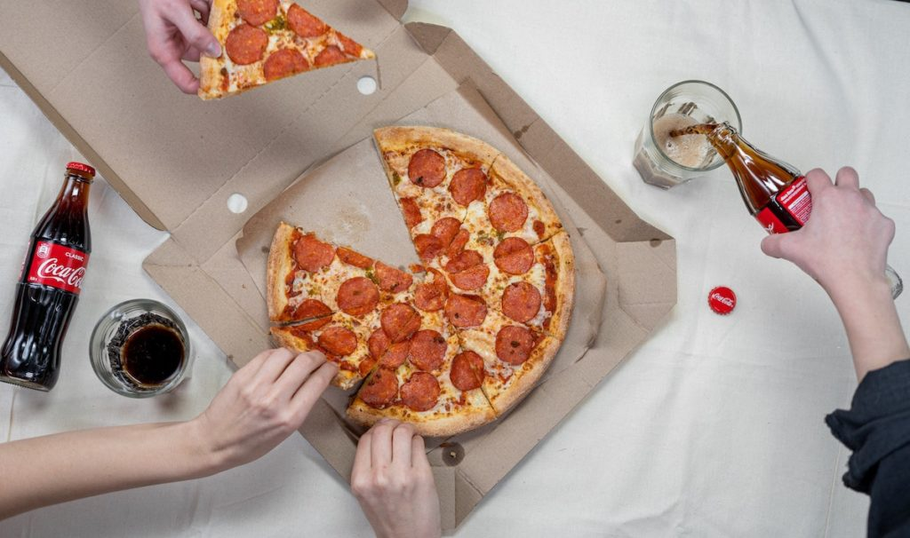 getting a slice of pizza