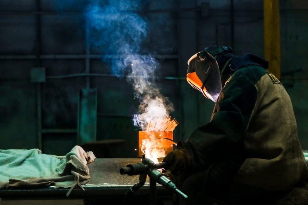 Welder in proper welding clothing