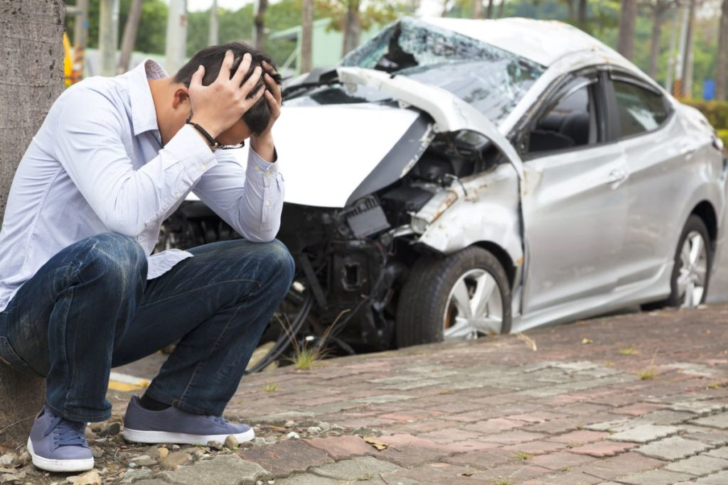 man holding head after vehicular accident